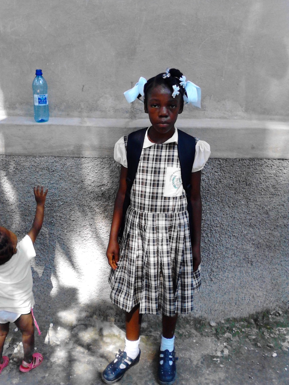 Clerona, the young girl who inspired the Clean Hands for Haiti program, in 2013, shortly after she began school. Clerona would wake up in the early dawn to cook, clean, and do household chores while other kids her age were getting to go to school. She transferred that hard work to her studies and within a year at school, was one of the top students in her class.