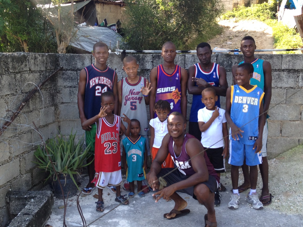 Founder Ray Abellard in 2014 with some of the first sponsored students in the program.
