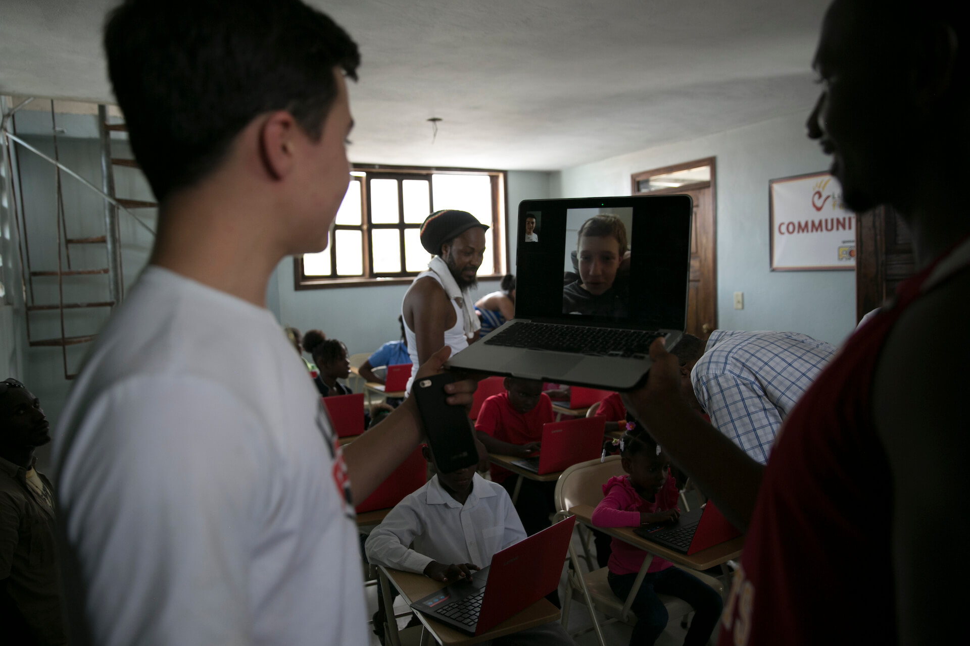 Lorenzo Tobin, one of our A&M Student Atheletes, leads a Skype call between some of our sponsored students in Haiti and our student atheletes in New York. They got to meet each other and ask quesionts about their lives,