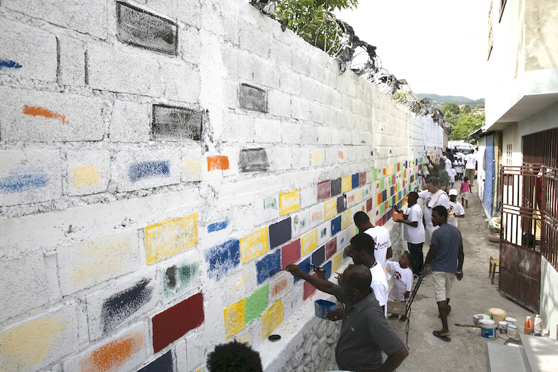 Over 50 people from the neighborhood came out to help us painting the walls leading up to the Community Center.