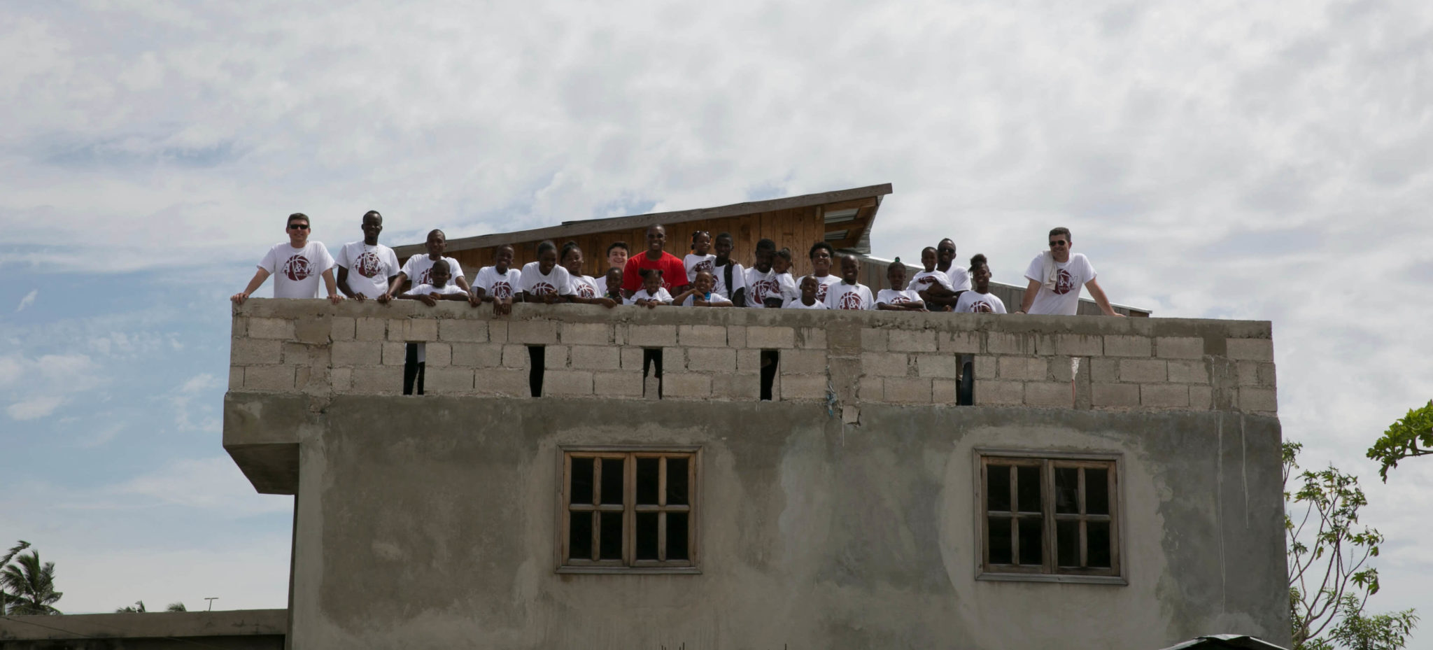 Some of our students and team on the roof of the Community Center.